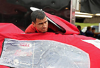 May 3, 2013; Commerce, GA, USA: NHRA crew member for funny car driver Cruz Pedregon while waiting out the rain delay before postponing qualifying to the following week for the Southern Nationals at Atlanta Dragway. Mandatory Credit: Mark J. Rebilas-