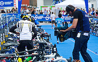 17 JUL 2011 - HAMBURG, GER - A television cameraman films Kathrin Muller (GER) as she prepares in transition for the start of the women's Hamburg round of triathlon's ITU World Championship Series (PHOTO (C) NIGEL FARROW)