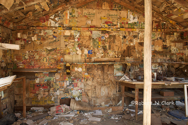 Interior of Burro Schmidt's cabin showing magazines and newspapers used to insulate the walls and ceiling