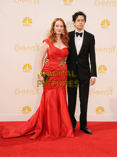 LOS ANGELES, CA- AUGUST 25: Actress Christina Hendricks (L) and Geoffrey Arend arrive at the 66th Annual Primetime Emmy Awards at Nokia Theatre L.A. Live on August 25, 2014 in Los Angeles, California.<br /> CAP/ROT/TM<br /> &copy;Tony Michaels/Roth Stock/Capital Pictures