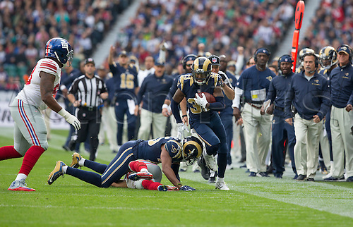 23.10.2016. Twickenham, London, England. NFL International Series. New York Giants versus LA Rams. Los Angeles Rams Right Cornerback E.J. Gaines makes a run with the ball along the side line in the first quarter with Los Angeles Rams Head Coach Jeff Fisher watching from the team side line.