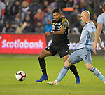 Joman Aguilar of Independiente (left) and Botond Barath of Sporting KC vie for the ball. Sporting KC defeated Club Atletico Independiente 3-0 in a CONCACAF Champions League quarterfinal game at Children's Mercy Park on March 14, 2019.