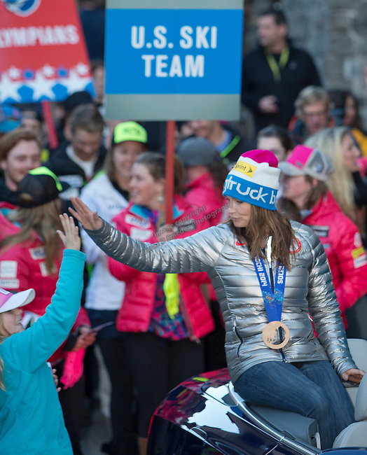 Julia Mancuso and members of the US Olympic Ski Team ride in a parade during the Olympic Homecoming Celebration at Squaw Valley on Friday night, March 21, 2014.