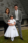 Saoirse Lawler pictured with her parents Fidelma and Fintan after she made her First Holy Communion in Julianstown on Saturday.