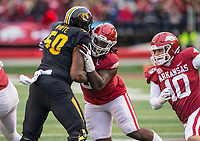 Hawgs Illustrated/BEN GOFF <br /> McTelvin Agim, Arkansas defensive tackle, handles his blocking assignment against Hyron White, Missouri right tackle, in the third quarter Saturday, Nov. 29, 2019, at War Memorial Stadium in Little Rock.