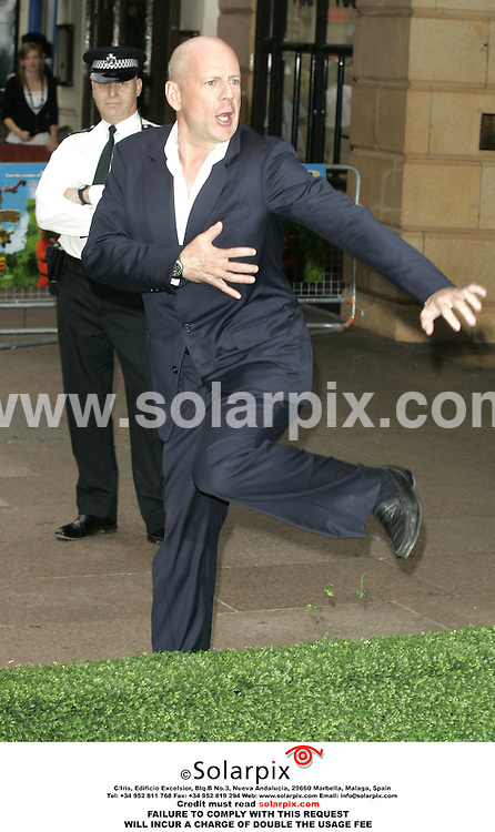 """ALL ROUND PICTURES FROM SOLARPIX.COM..Bruce Willis arrives for the premiere of """"Over The Hedge"""" at the Vue West End, Leicester Square on 22.06.06.  Job Ref: 2518/PRS..MUST CREDIT SOLARPIX.COM OR DOUBLE FEE WILL BE CHARGED."""