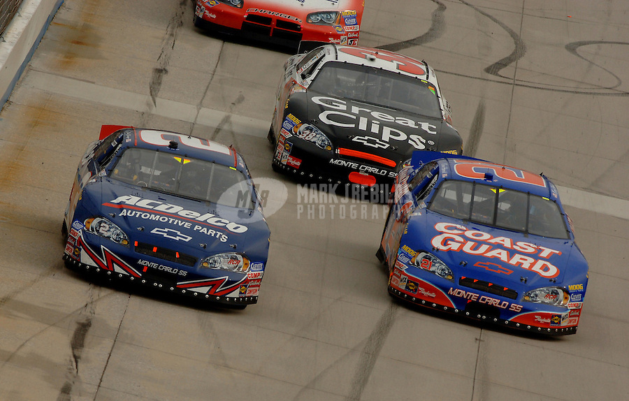 Sept. 23, 2006; Dover, DE, USA; Nascar Busch Series driver Clint Bowyer (2) races Kevin Harvick (21) during the Dover 200 at Dover International Speedway. Mandatory Credit: Mark J. Rebilas