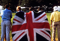 English supporters at a gold tournament wrapped in Union Jack flag