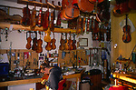 A3AATA Craftswoman at work Violin shop interior Woodbridge Suffolk England