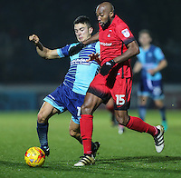 Luke O'Nien of Wycombe Wanderers and Nigel Atangana of Leyton Orient (15)during the Sky Bet League 2 match between Wycombe Wanderers and Leyton Orient at Adams Park, High Wycombe, England on 17 December 2016. Photo by David Horn / PRiME Media Images.