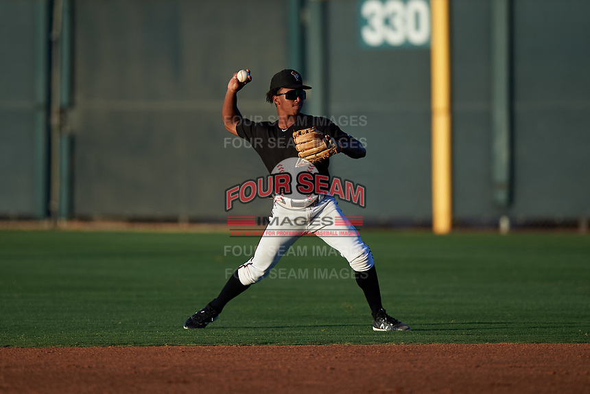 AZL D-backs second baseman Glenallen Hill Jr. (6) throws to first base during an Arizona League game against the AZL Angels on July 20, 2019 at Salt River Fields at Talking Stick in Scottsdale, Arizona. The AZL Angels defeated the AZL D-backs 11-4. (Zachary Lucy/Four Seam Images)