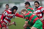 Ethan James provides support to Manukia Manuika as he tries to break through the tackle of Reynold Leelo. Counties Manukau Premier Club Rugby game between Waiuku & Karaka played at Waiuku on Saturday July 4th 2009. Waiuku won the game 22 - 7.