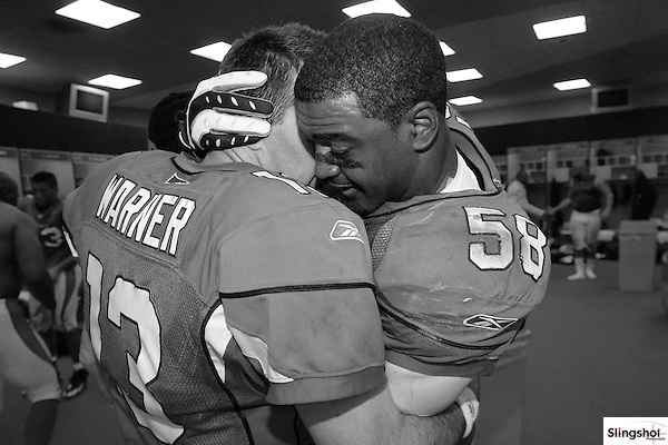 Arizona Cardinals quarterback Kurt Warner and linebacker Karlos Dansby embrace in the locker room after an overtime defensive touchdown by Danby.  It would also be Kurt Warner's last home game of his career against the Green Bay Packers on January 10th, 2010 at University of Phoenix Stadium in Glendale, AZ.