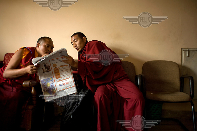 Buddhist monks reading a newspaper at the Vajra Vidya Institute for Buddhist Studies in Sarnath.