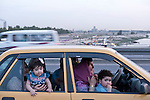 Mcc0070043 . Daily Telegraph<br /> <br /> DT News<br /> <br /> A family sitting in their car on Jadriyha bridge , Baghdad . <br /> <br /> Baghdad 13 May 2016