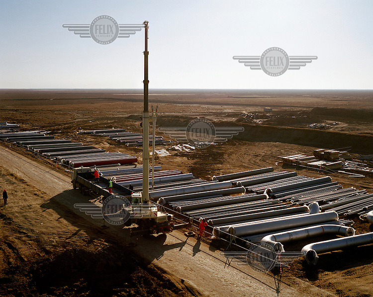 Construction of pipelines at the Bolashak Onshore Processing Plant. The facility, which processes oil from the Kashagan field, is run by Agip KCO on behalf of a consortium which consists of Shell, Exxon Mobil, Total, ConocoPhillips, Eni, KazMunayGas and Inpex. The discovery of Kashagan's commercial reserve of around 13 billion barrels of oil in 2000 was one of the largest finds in decades.