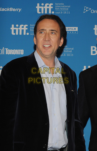 "Nicolas Cage.""Trespass"" Press Conference held at TIFF Bell Lightbox during the 2011 Toronto International Film Festival, Toronto, Ontario, Canada..September 14th, 2011.half length black blue suit jacket shirt velvet.CAP/ADM/BPC.©Brent Perniac/AdMedia/Capital Pictures."