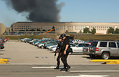 Washington, DC - September 11, 2001 -- Heavily armed police patrol the parking lot around the Pentagon following the terrorist attack on Tuesday, September 11, 2001..Credit: Ron Sachs / CNP