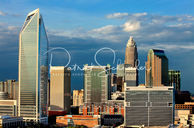 Charlotte NC skyline photography updated May 21, 2011. Skyscrapers in image include Duke Energy Center tower (left), Bank of America tower (tall in center) and Wells Fargo tower (right, rounded top). For research help in locating stock images or Charlotte NC photos available for purchase or licensing, please call 704-655-2661.