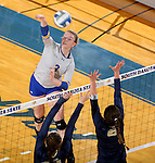 BROOKINGS, SD - OCTOBER 28:  Makenzie Hennen #3 from South Dakota State tries for a kill past a pair of defenders including Lucija Bojanjac #6 from Oral Roberts Friday night at Frost Arena in Brookings. (Photo by Dave Eggen/Inertia)