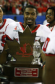 January 5th, 2008:  Rutgers player Marcus Daniels (9) poses with the championship trophy after the International Bowl at the Rogers Centre in Toronto, Ontario Canada...Rutgers defeated Ball State 52-30.  ..Photo By:  Mike Janes Photography