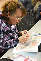 NWA Democrat-Gazette/FLIP PUTTHOFF <br /> ONE BEAD AT A TIME<br /> Quita Rusher works Wednesday March 13 2019 on her diamond painting project during a class at the Rogers Adult Wellness Cneter. The art of diamond painting involves placing tiny colored beads on a pre-made pattern to create a picture. It's similar to embroidery, cross stitch and paint by numbers, said Jackie Jackson, teacher. One picture contains hundreds of colored beads.