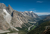 The green Val Veny runs beside the bare rock and ice of the Mont Blanc Massif.