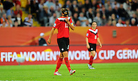 Diana Matheson (r) and Christine Sinclair of team Canada react during the FIFA Women's World Cup at the FIFA Stadium in Dresden, Germany on July 5th, 2011.