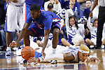 UK forward Willie Cauley-Stein and Boise State guard Mikey Thompson scrambling after a loose ball during the second half of the UK basketball game vs. Boise State on Tuesday, December 10, 2013, in Lexington, Ky. Photo by Kalyn Bradford | Staff