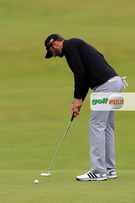 Dustin JOHNSON (USA) putts on the 18th green during Sunday's Round 3 of the 144th Open Championship, St Andrews Old Course, St Andrews, Fife, Scotland. 19/07/2015.<br /> Picture Eoin Clarke, www.golffile.ie