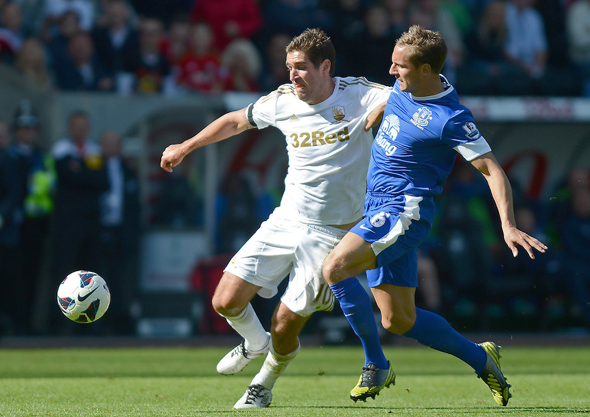 Swansea City's Danny Graham battles with Everton's Phil Jagielka ..Football - Barclays Premiership - Swansea City v Everton - Saturday 22nd September 2012 - Liberty Stadium - Swansea..