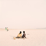 Young couple enjoy the evening on picnic island in Patna, Bihar.