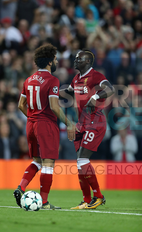 Mohamed Salah of Liverpool celebrates scoring with Sadio Mane of Liverpool during the Champions League playoff round at the Anfield Stadium, Liverpool. Picture date 23rd August 2017. Picture credit should read: Lynne Cameron/Sportimage
