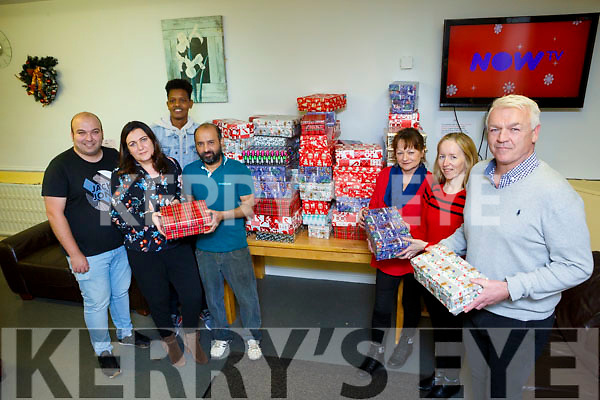 The Tralee International Resource Centre deliver Christmas parcels to Atlas House in McCowans Lane on Monday evening last. Front right are, Mary O'Sullivan & Mary Carroll, with Atlas House manager Jim Carneige. Back l to r; Zaid Kassoob, Catherine Leen, Khudur Hasan, Ripon Islam.