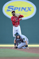 Second baseman Kervin Suarez (36) of the Greenville Drive, playing as the Energia in MiLB's Copa de la Diversion, makes the out on Shane Matheny (15) of the Augusta GreenJackets and turns a double play in a game on April 10, 2019, at Fluor Field at the West End in Greenville, South Carolina. Augusta won, 9-8. (Tom Priddy/Four Seam Images)