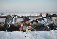OutdoorLife Editor Andrew McKean (cq) shoots out of a duck blind in near Grand Island, Nebraska, Sunday, December 4, 2011.