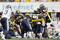 September 6, 2010; Hamilton, ON, CAN; Hamilton Tiger-Cats defensive tackle Demonte' Bolden (90) and defensive end Justin Hickman (95) tackle Toronto Argonauts quarterback Cleo Lemon (1) on a short yard play. CFL football: Labour Day Classic - Toronto Argonauts vs. Hamilton Tiger-Cats at Ivor Wynne Stadium. The Tiger-Cats defeated the Argonauts 28-13. Mandatory Credit: Ron Scheffler.