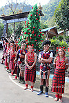 lining up in front of the Christmas tree at the entrance to the festival arena, Kisama Heritage village