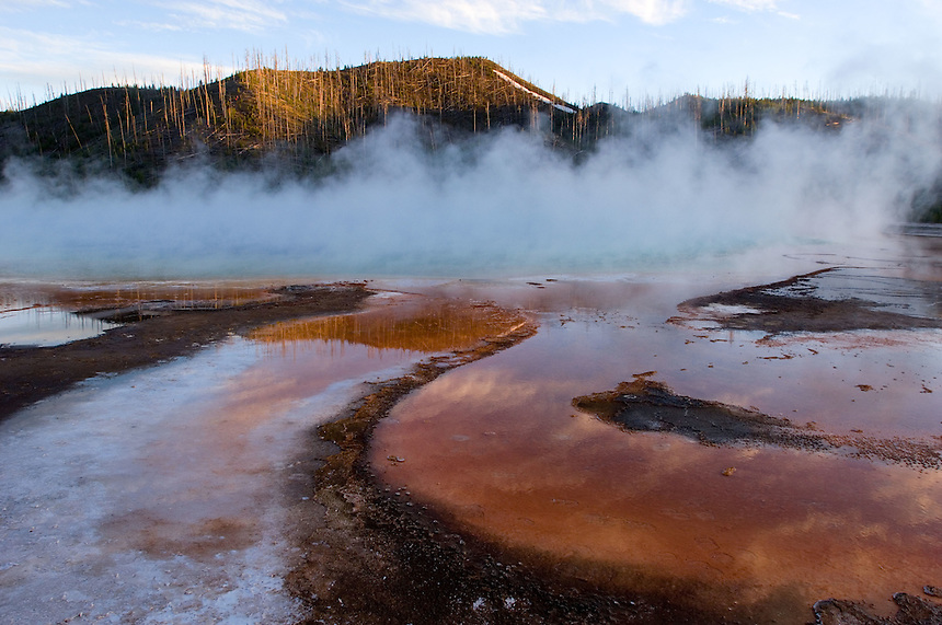Steam rises from the Grand Prismatic Spring on the Midway Geyser Basin in Yellowstone National Park, Monday, May 30, 2005. (Kevin Moloney for the New York Times)
