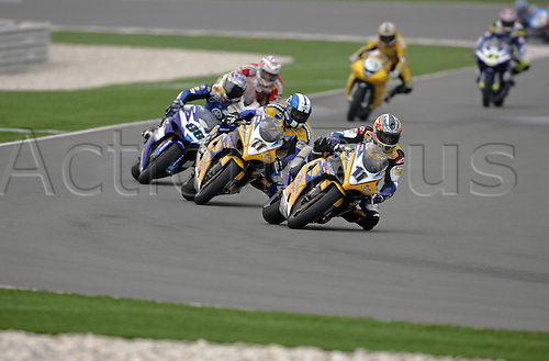 26 February 2005: Australian rider Troy Corser (AUS) on his Alstare Suzuki Corona Extra GSXR1000 K5 leads Kagayama into turn two during the first race of round one of the SBK Superbike World Championship held at the Losail International Circuit, Doha, Qatar. Photo: Neil Tingle/Action Plus..050226 motorcycling motorcycle racing bike racing SBK sport motor sports motorsport motorsports
