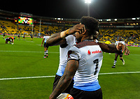 Fiji captain Kevin Naiqama is hugged during the 2017 Rugby League World Cup quarterfinal match between New Zealand Kiwis and Fiji at Wellington Regional Stadium in Wellington, New Zealand on Saturday, 18 November 2017. Photo: Dave Lintott / lintottphoto.co.nz
