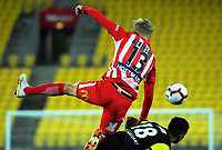 Nathaniel Atkinson beats Sarpreet Singh to a header during the A-League football match between Wellington Phoenix and Melbourne City FC at Westpac Stadium in Wellington, New Zealand on Sunday, 21 April 2019. Photo: Dave Lintott / lintottphoto.co.nz
