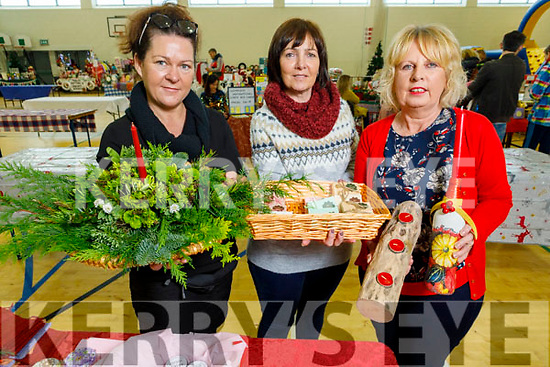 Mags O'Grady, Nodie Slattery and Kathleen White from Ballyduff displaying their crafts at the John Mitchels GAA Club Christmas Market on Saturday.