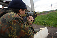 A Pro-Russian soldier provide visual covering of the area at a railroad checkpoint. Slavyansk, Donetsk region.