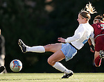UNC's Lindsay Tarpley (center) gets a shot off while under pressure from Florida State's Sarah Wagenfuhr (5) on Friday, November 25th, 2005 at Fetzer Field in Chapel Hill, North Carolina. The Florida State Seminoles defeated the University of North Carolina Tarheels 5-4 on penalty kicks after the teams tied 1-1 after overtime during their NCAA Women's Soccer Tournament quarterfinal game.