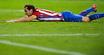 Diego Roberto Godin Leal of Club Atletico de Madrid falls during their La Liga match between Club Atletico de Madrid and Malaga CF at the Estadio Vicente Calderón on 29 October 2016 in Madrid, Spain. Photo by Diego Gonzalez Souto / Power Sport Images