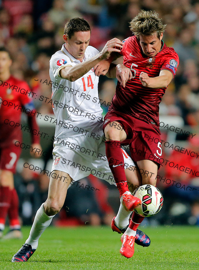 Nemanja Matic Fabio Coentrao Uefa EURO 2016 qualifying football match between Portugal and Serbia in Lisboa, Portugal on March 29. 2015.  (credit image & photo: Pedja Milosavljevic / STARSPORT)