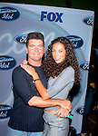 Simon Cowell (American Idol judge) and Terri Seymour at party to celebrate the American Idol Top 12 Finalists at Pearl in Hollywood.