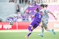 Orlando, FL - Sunday May 14, 2017: Camila, Abby Erceg during a regular season National Women's Soccer League (NWSL) match between the Orlando Pride and the North Carolina Courage at Orlando City Stadium.