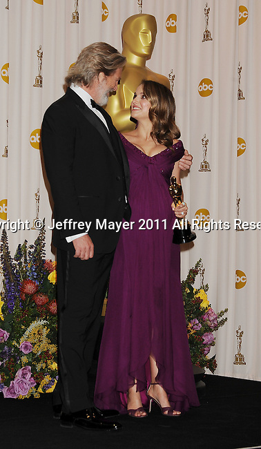 HOLLYWOOD, CA - FEBRUARY 27: Jeff Bridges and Natalie Portman pose in the press room during the 83rd Annual Academy Awards held at the Kodak Theatre on February 27, 2011 in Hollywood, California.